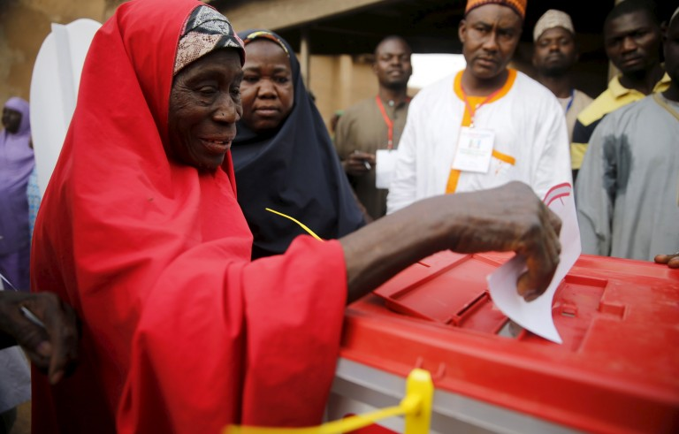 A woman casts her vote at a polling unit in Daura, northwest Nigeria, on March 28. Photo by Akintunde Akinleye/Reuters