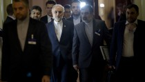 Head of Iranian Atomic Energy Organization Ali Akbar Salehi walks with others during a break in a meeting with world representatives seeking to pin down a nuclear deal with Iran at the Beau Rivage Palace Hotel in Lausanne