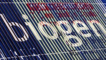 The company's name is displayed on a billboard near the headquarters of Biogen Idec Inc. in Cambridge