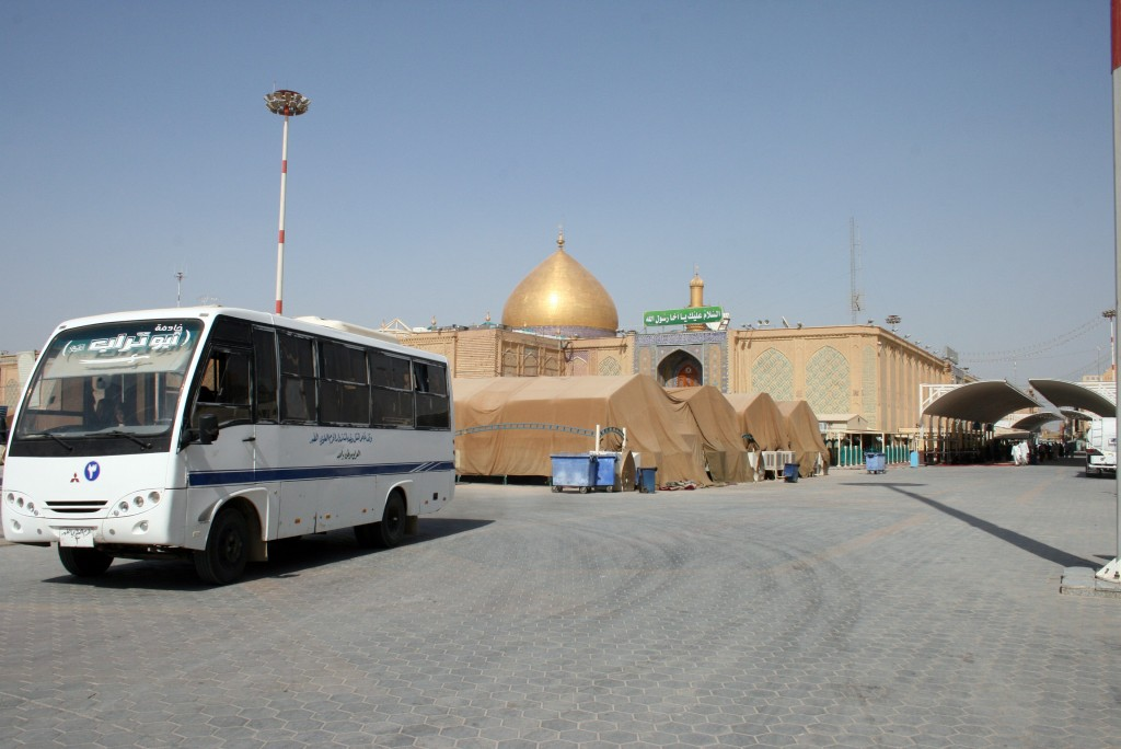 Buses Circulate Pilgrims arrive by the busload to pray at the gold-domed shrine. Najaf Gov. Adnan Al-Zurufi told us 1.5 million visitors come each year, more than double the population of the city. Photo by Larisa Epatko
