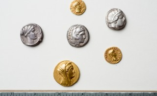 Rare and priceless Greek and Roman coins discovered after spending 80 years in a vault at the University at Buffalo. Credit: Douglas Levere / University at Buffalo