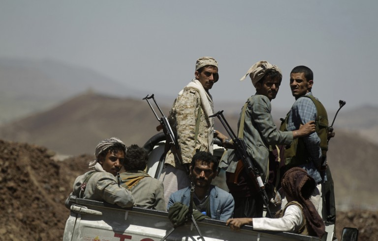 Shi'ite Houthi rebels ride on a truck at the compound of the army's First Armoured Division, after they took over it, in Sanaa