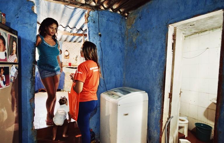 A Mobile Metrix agent asks survey questions of a resident in Rio de Janeiro, Brazil. Photo courtesy of Mobile Metrix