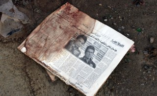 Newspaper A blood-stained newspaper dated Aug. 17 is part of the debris.