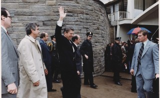 "At 2:27 p.m. on March 30, 1981, John Hinckley, Jr. opened fire from behind a ropeline at the Washington Hilton Hotel. Former Secret Service agent Jerry Parr, left behind President Reagan, is credited with saving the president's life twice that day, first by pushing him headfirst into a waiting limousine, then by making the decision to change course and take ""Rawhide,"" President Reagan's code name, to George Washington University Hospital instead of the White House. Photo courtesy of National Archives."