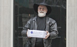 British author Terry Pratchett poses for a photograph while holding a petition on the behalf of the Alzheimer's Research Trust in London on Nov. 26, 2008. Photo by Suzanne Plunkett/Reuters