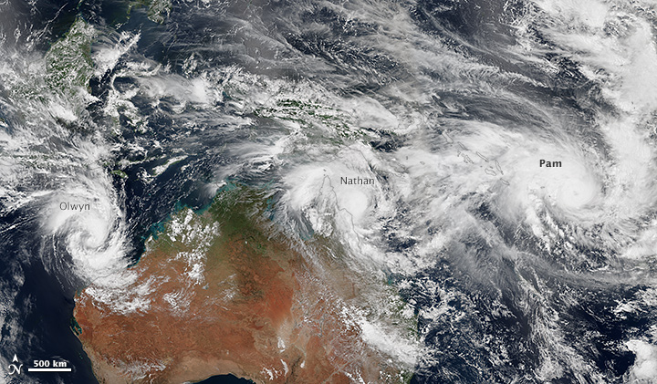 It has been an unusually busy week for tropical cyclones in the vicinity of Australia. This mosaic shows three storms -- Pam, Nathan and Olwyn -- swirling near the continent on March 11, 2015. Image courtesy of NASA