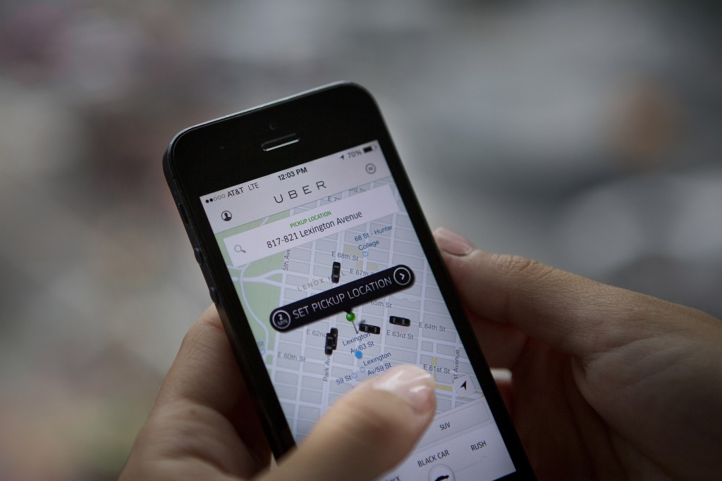 The Uber Technologies Inc. car service application is demonstrated for a photograph on an Apple Inc. iPhone in New York, U.S., on Wednesday, Aug. 6, 2014. Photo by Victor J. Blue/Bloomberg via Getty Images.