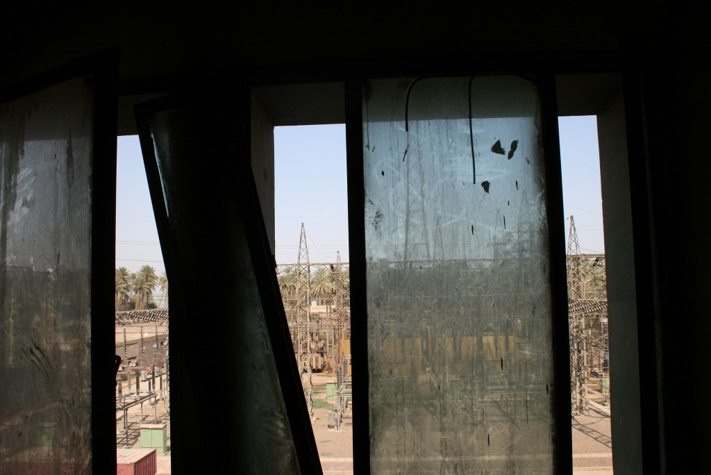 Window to the Yard Through dilapidated windows is a view of the plant's switchyard. All photos by Larisa Epatko