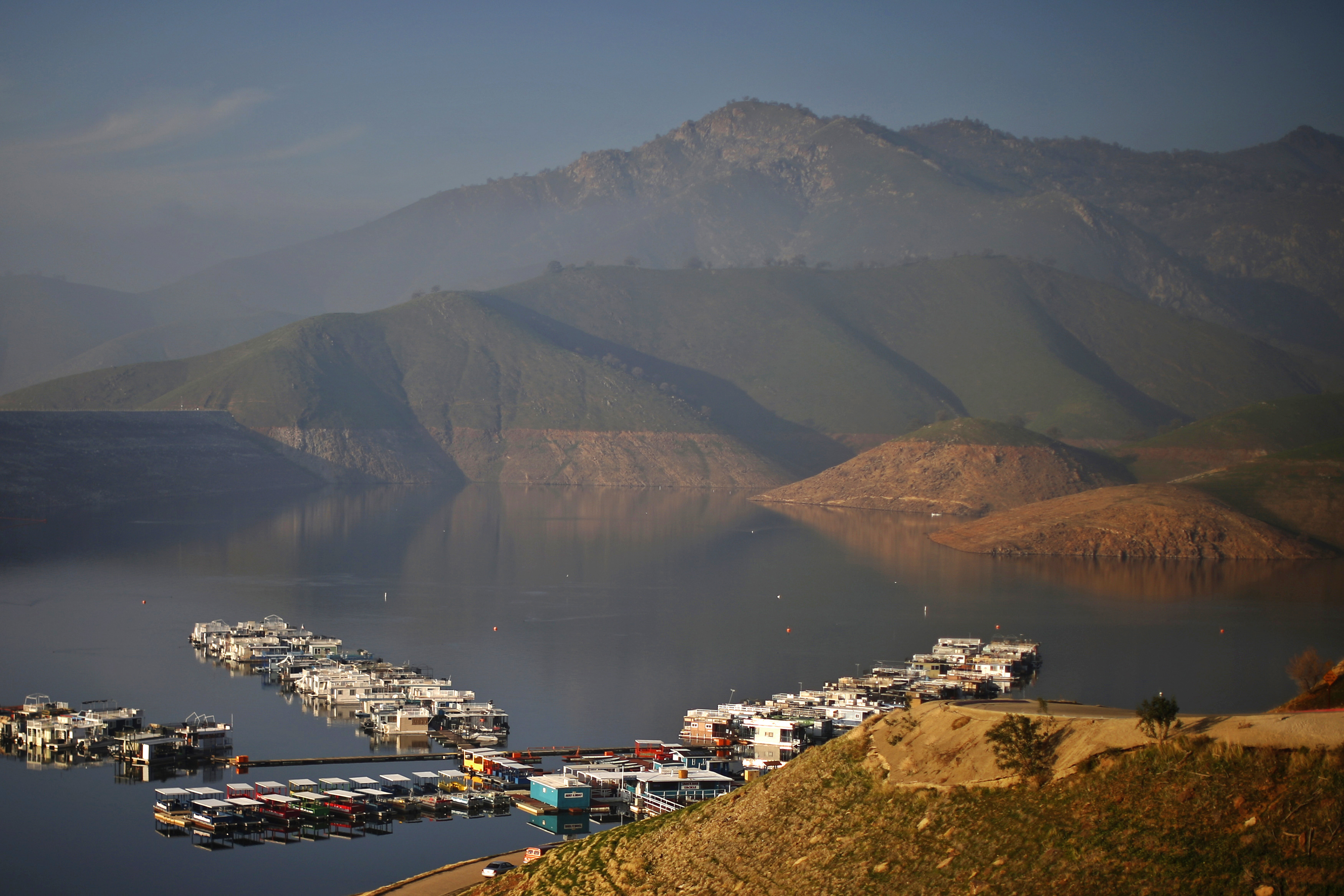 Houseboats sit on Lake Kaweah, well below the visible high-water mark in Lemon Cove, California January 17, 2015. Photo by Lucy Nicholson/Reuters