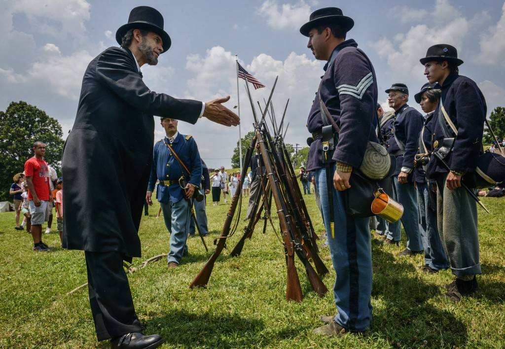 Scott Sedar, left, as Abraham Lincoln, greets members of the 61st Pennsylvania as Fort Stevens celebrates the 150th anniversary of the Civil war battle fought there, on July, 12, 2014 in Washington, D.C. Photo by Bill O'Leary/The Washington Post via Getty Images