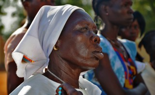 A woman attends a mass in Juba, South Sudan, on Dec. 15, 2014 to commemorate one year since the outbreak of the South Sudan civil war. The names of some of those killed in the fighting were released. With no official toll, South Sudanese civil society volunteers have spent months collecting, cross checking and confirming the names of those killed. Photo by Samir Bol/AFP/Getty Images