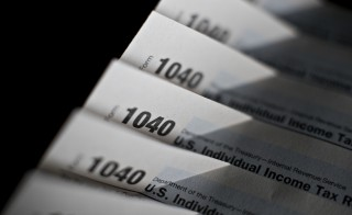 U.S. Department of the Treasury Internal Revenue Service (IRS) 1040 Individual Income Tax forms for the 2014 tax year are arranged for a photograph in Tiskilwa, Illinois, U.S., on Monday, March 16, 2015. The deadline for filing 2014 U.S. income taxes is Wednesday, April 15, 2015. Photographer:  Daniel Acker/Bloomberg via Getty Images