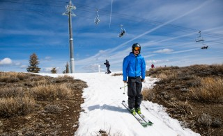 A skier threads his way through patches of dry ground at Squaw Valley Ski Resort in Olympic Valley, California,  on March 21. Many Tahoe-area ski resorts have closed due to low snowfall as California's historic drought continues. Photo by Max Whittaker/Getty Images