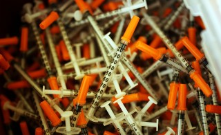 ST. JOHNSBURY, VT - FEBRUARY 06: Used syringes are discarded at a needle exchange clinic where users can pick up new syringes and other clean items for those dependent on heroin on February 6, 2014 in St. Johnsbury, Vermont. Vermont Governor Peter Shumlin recently devoted his entire State of the State speech to the scourge of heroin. Heroin and other opiates have begun to devastate many communities in the Northeast and Midwest leading to a surge in fatal overdoses in a number of states. As prescription painkillers, such as the synthetic opiate OxyContin, become increasingly expensive and regulated, more and more Americans are turning to heroin to fight pain or to get high. Heroin, which has experienced a surge in production in places such as Afghanistan and parts of Central America, has a relatively inexpensive street price and provides a more powerful affect on the user.  (Photo by Spencer Platt/Getty Images)