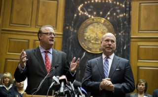 Indiana Senate President Pro Tem David Long speaks as House Speaker Brian Bosma looks on during a press conference about anti-discrimination safeguards added to the controversial Religious Freedom Restoration Act. Photo by Aaron P. Bernstein/Getty Images