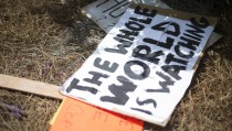 Police shooting protest sign