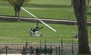 A man was arrested after landing a gyrocopter on the West Lawn of the U.S. Capitol . The small helicopter was painted with a U.S. Postal Service logo. Photo By Bill Clark/CQ Roll Call