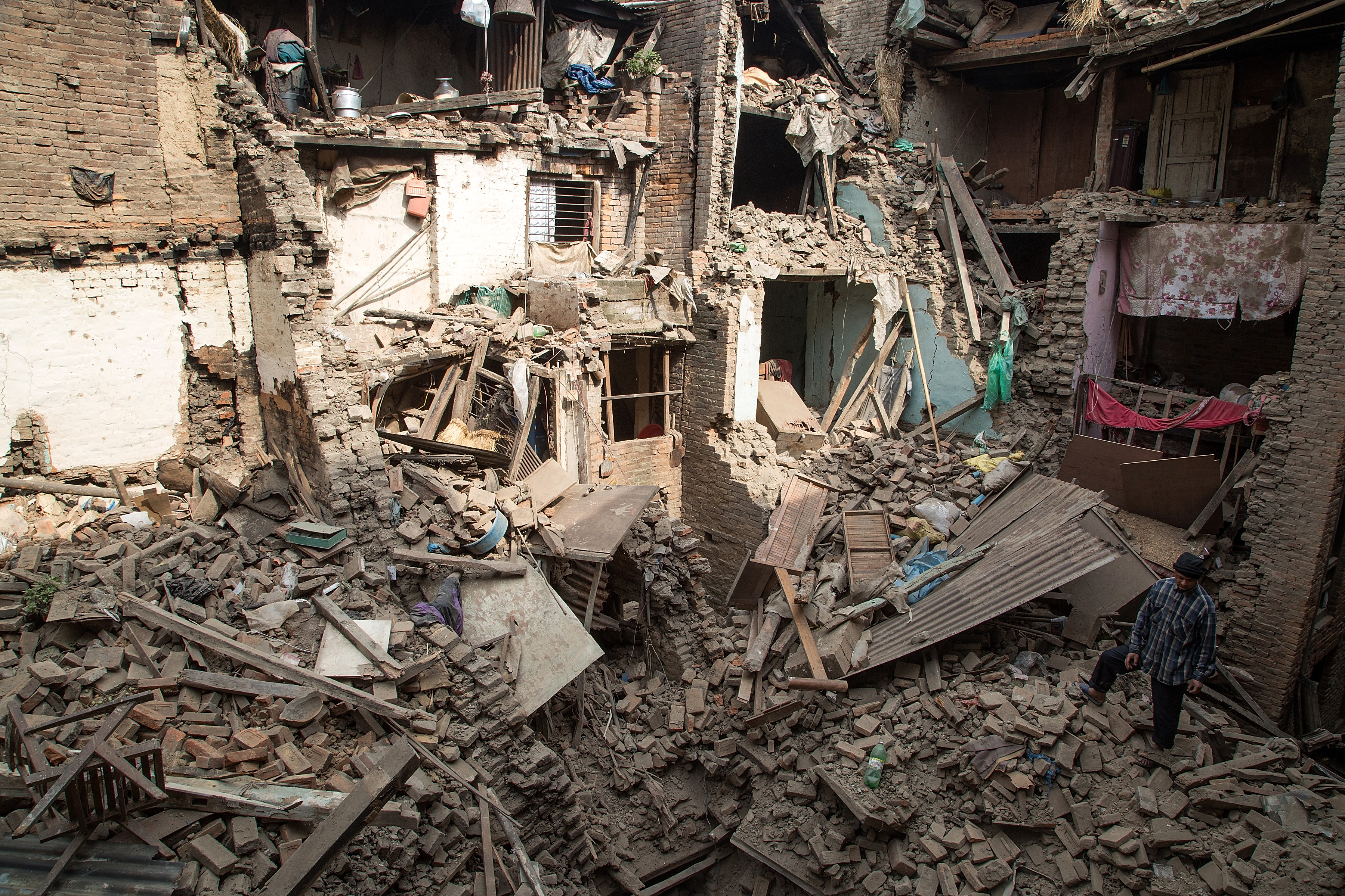 <> on April 26, 2015 in Kathmandu, Nepal. A major 7.8 earthquake hit Kathmandu mid-day on Saturday, and was followed by multiple aftershocks that triggered avalanches on Mt. Everest that buried mountain climbers in their base camps. Many houses, buildings and temples in the capital were destroyed during the earthquake, leaving thousands dead or trapped under the debris as emergency rescue workers attempt to clear debris and find survivors.