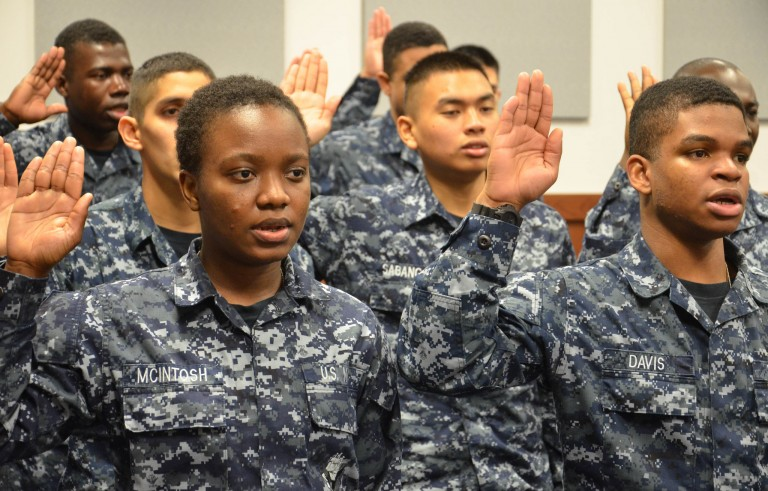 Immigrants who were recruited to join the U.S. Navy take the oath of citizenship during a naturalization ceremony in the United States. A new report from the Pew Research Center found that the black immigrant community has grown dramatically since 1980 and will continue to rise for years to come. Photo by  Official U.S. Navy Page/Flickr.