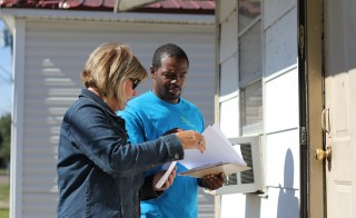 Workers from the Delta Health Alliance conduct door-to-door surveys in fall 2014. (Photo: Jackie Mader)