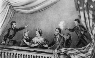 Lithograph of the Assassination of Abraham Lincoln. From left to right: Henry Rathbone, Clara Harris, Mary Todd Lincoln, Abraham Lincoln, and John Wilkes Booth. Rathbone is depicted as spotting Booth before he shot Lincoln and trying to stop him as Booth fired his weapon. Rathbone actually was unaware of Booth's approach, and reacted after the shot was fired. While Lincoln is depicted clutching the flag after being shot, it is also possible that he just simply pushed the flag aside to watch the performance. From the Library of Congress