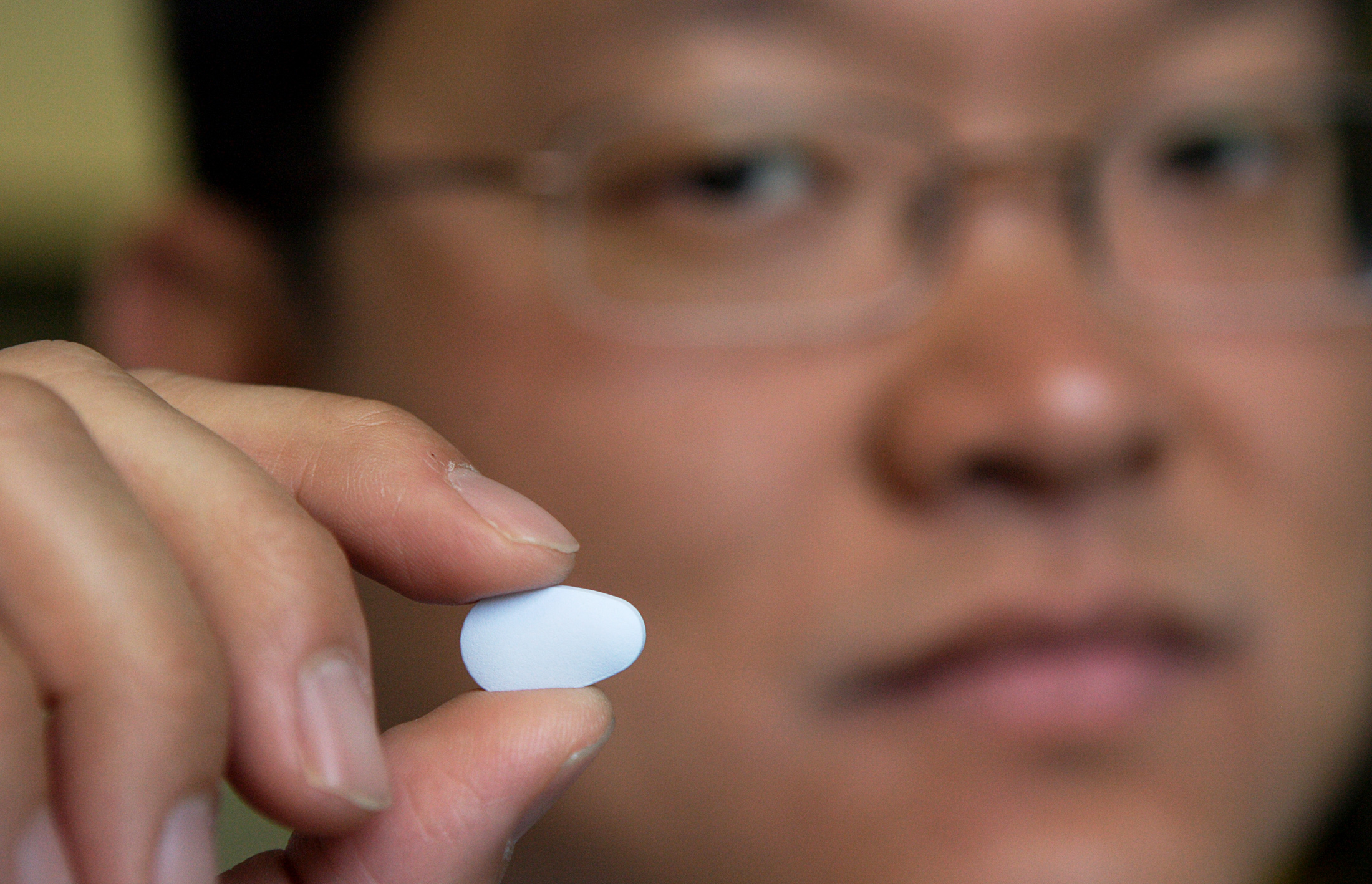 Dr. Albert Liu, director of HIV Prevention Intervention Studies at San Francisco's Department of Public Health, holds a Truvada pill in San Francisco, California, August 8, 2006. The drug is the basis of a controversial HIV-prevention technique called PrEP. Photo by Kimberly White/Reuters