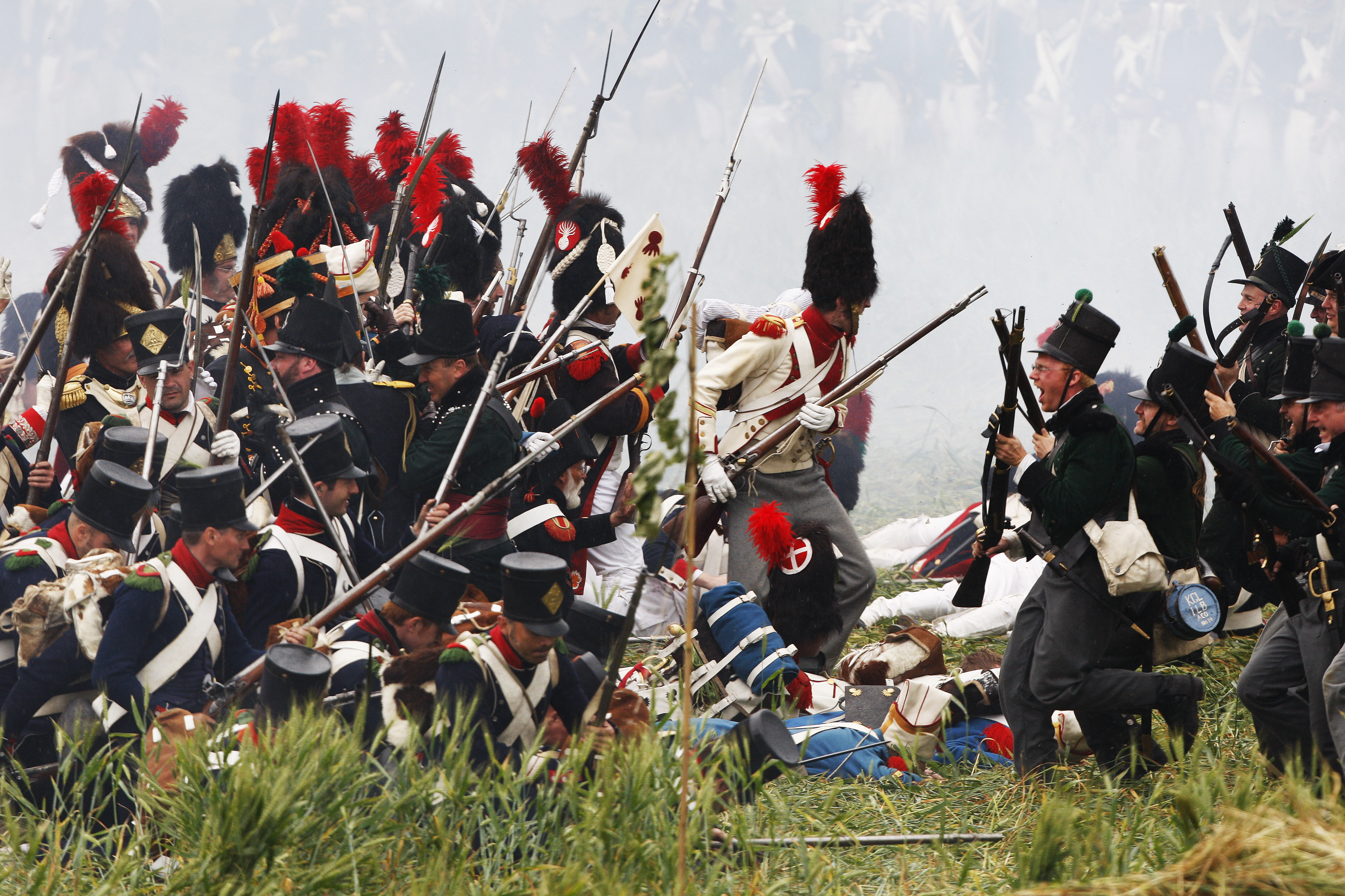 History enthusiasts, dressed as members of the French and British Army, fight during a re-enactment of Napoleon's famous battle of Waterloo in Braine-l'Alleud June 21, 2009. 2015 marks the 200th anniversary of the decisive battle. Credit: Thierry Roge/REUTERS