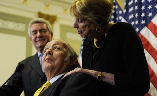 James Brady (C), former White House Press Secretary under Ronald Reagan, looks up at his wife Sarah Brady (R) during a news conference to urge members of Congress for progress on gun control legislation, specifically passage of a ban on large-capacity ammunition clips, in Washington, March 30, 2011. Wednesday marked the 30th anniversary of the assassination attempt on Reagan, during which Brady was seriously injured by a shot to the head. Also pictured is Brady Campaign President Paul Helmke (L). Photo by Jonathan Ernst/Reuters