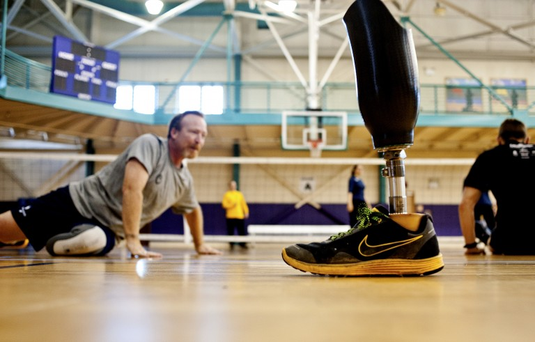 A prosthetic calf of a Wounded Warrior is set aside during a sitting volleyball game during an adaptive athletics camp for wounded soldiers at Naval Station Norfolk, Virginia on Feb. 8, 2013. The U.S. Army is closing some specialized medical units now that the wars in Iraq and Afghanistan are winding down. Photo by Rich-Joseph Facun/Reuters