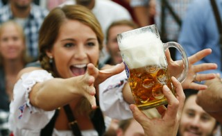 Today is National Beer Day in the U.S. Although this photo is from the opening ceremony for the 180th Munich Oktoberfest in 2013, we thought it captured the spirit of America's love of the hoppy brew. Photo by Michael Dalder/Reuters