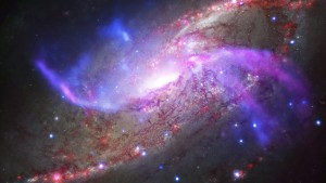 Composite image handout of the spiral galaxy NGC 4258