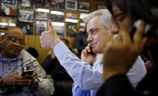 Chicago Mayor Rahm Emanuel gives a thumbs-up, while speaking to a potential voter at a phone bank, on election day in Chicago in February. Emanuel . Photo by Jim Young/Reuters