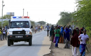 An ambulance is driven to the direction where attackers are holding up at a campus in Garissa