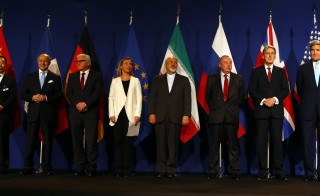 Western and Iranian officials pose during a joint statement in Lausanne