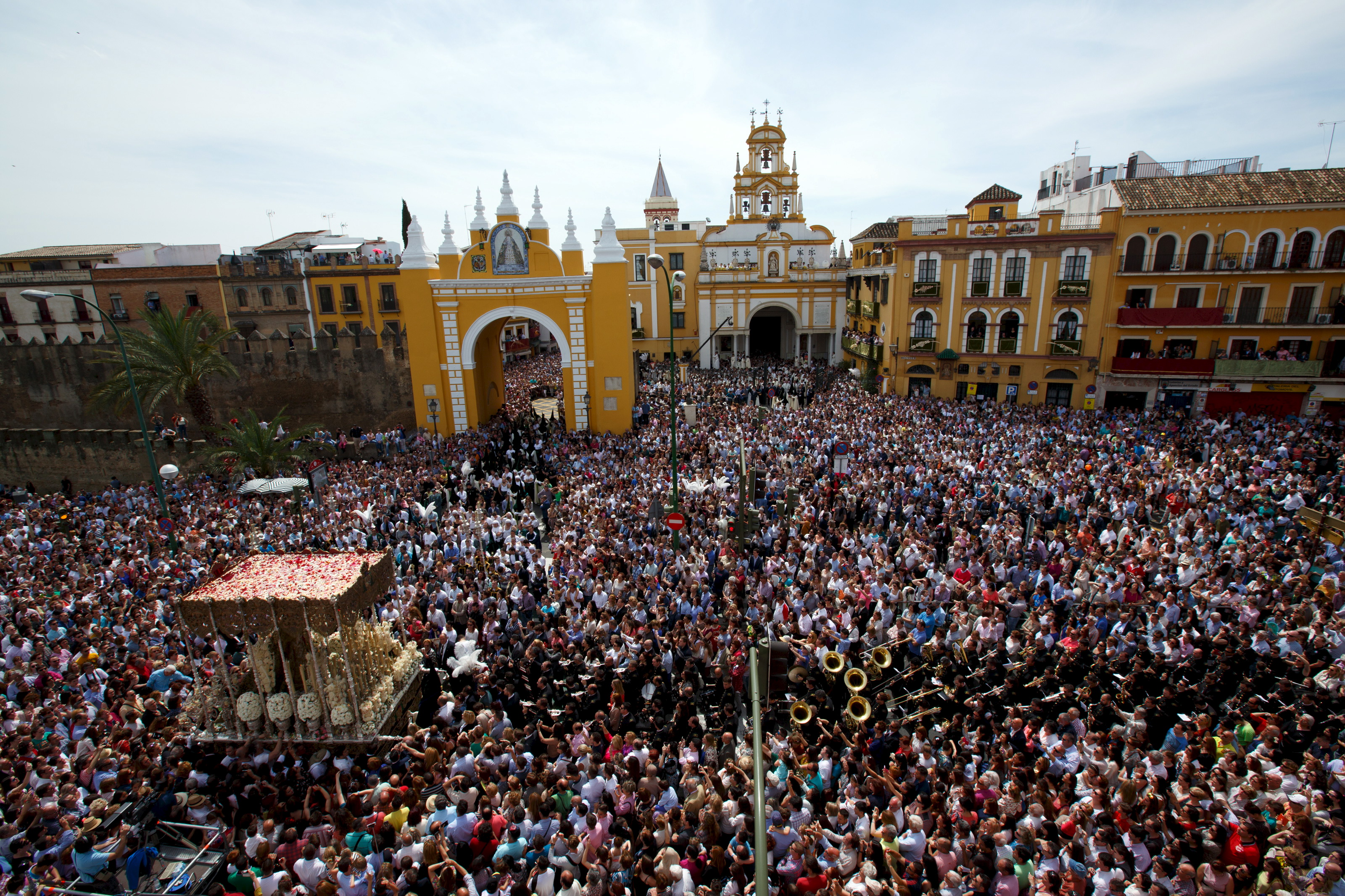 Crowds gather to watch Holy Week processions in Seville, Spain