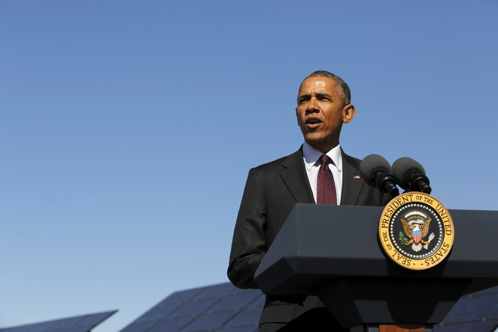 U.S. President Barack Obama delivers remarks on clean energy after a tour of a solar power array at Hill Air Force Base, Utah April 3, 2015. Photo by  REUTERS/Jonathan Ernst
