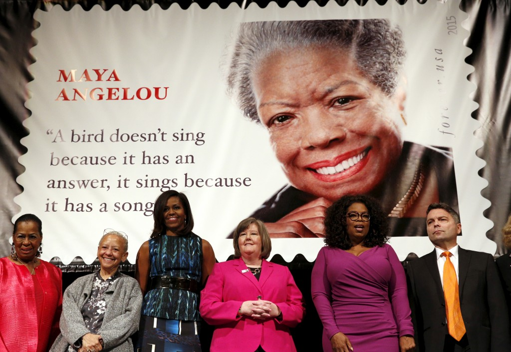 Howard University Professor Eleanor Traylor, writer Nikki Giovanni, first lady Michelle Obama, Postmaster General Megan Brennan, Oprah Winfrey and artist Ross Rossin dedicate the newest Forever stamp to author Maya Angelou. Photo by Kevin Lamarque/Reuters