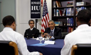 U.S. President Barack Obama participates in a roundtable discussion with U.S. Surgeon General Dr. Vivek Murthy (L) on the impacts of climate change on public health at Howard University in Washington April 7, 2015. Photo by Gary Cameron/Reuters