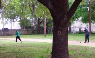 North Charleston police officer Michael Slager, right, is seen allegedly shooting 50-year-old Walter Scott in the back as he runs away, in this still image from video in North Charleston, South Carolina taken April 4, 2015. Slager was charged with murder on Tuesday. The FBI and U.S. Justice Department have begun a separate investigation. Handout photo via Reuters