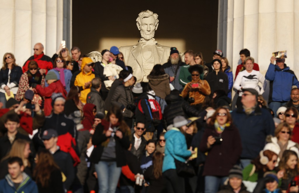 Crowds stand on the steps  at the Lincoln Memorial in Washington during an Easter morning sunrise religious service April 5, 2015. Photo by Jim Bourg/Reuters