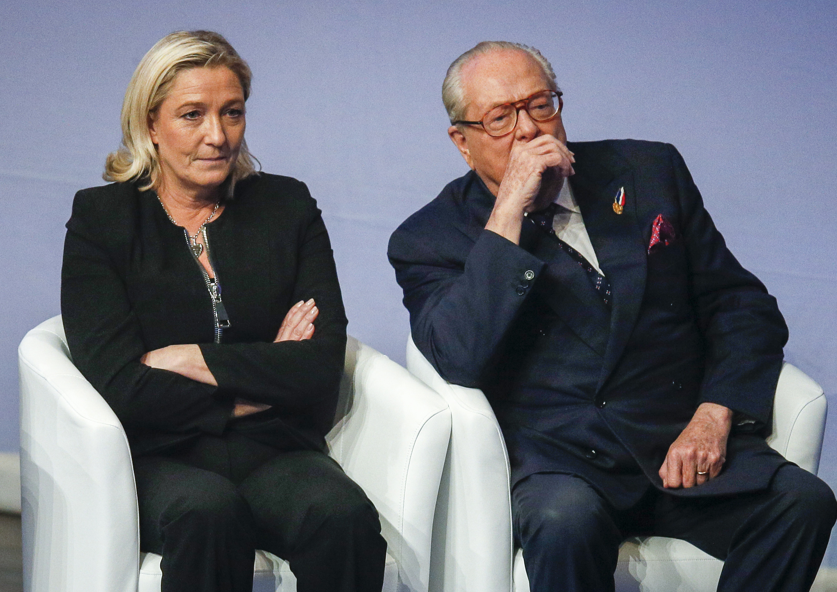 Marine Le Pen (L), France's National Front political party leader, and her father Jean-Marie Le Pen attend their party congress in Lyon, November 29, 2014. Marine Le Pen has called on her father to leave politics following his recent controversial comments. Photo by Robert Pratta/Reuters.