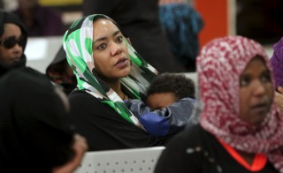 A woman waits for her evacuation flight at Sanaa airport on April 13. The flight did not land due to resumption of Saudi-led air strikes, airport officials said. Photo by Mohamed al-Sayaghi/Reuters