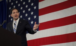 Republican presidential candidate U.S. Senator Marco Rubio (R-FL) speaks at the First in the Nation Republican Leadership Conference in Nashua, New Hampshire on April 17, 2015. In a campaign speech on Saturday Rubio called Vladimir Putin a criminal, and spoke about his parents' immigrant experience. Photo by Brian Snyder/Reuters
