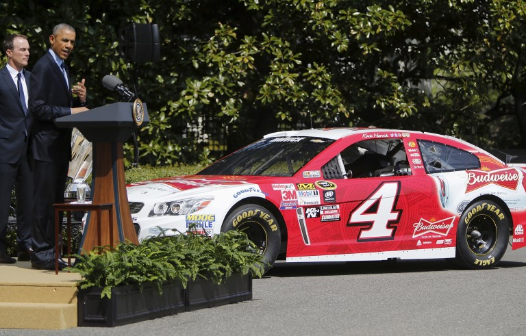 U.S. President Barack Obama stands with 2014 NASCAR Sprint Cup Series champion Kevin Harvick during a reception on the South Lawn of the White House. Photo by Jonathan Ernst /Reuters.
