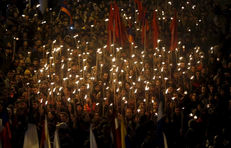 Demonstrators attend a torch-bearing march marking the centenary of the mass killing of Armenians by Ottoman Turks in Yerevan
