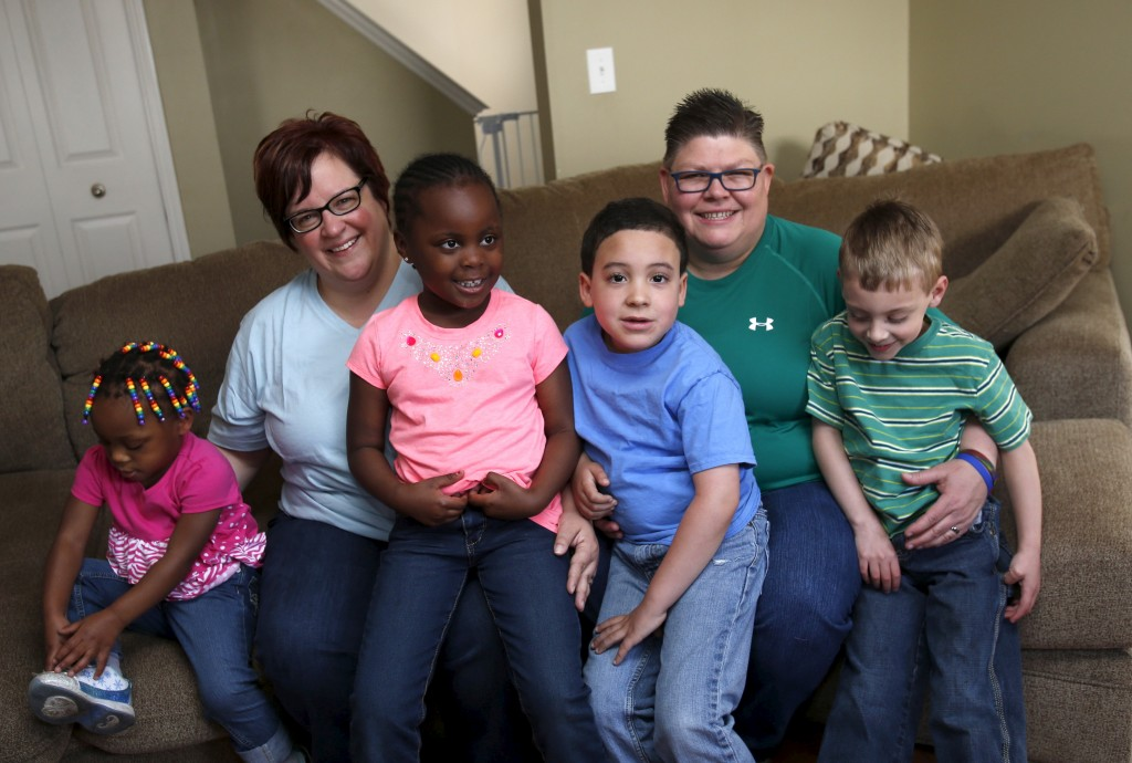 Michigan couple April DeBoer (2nd L) and Jayne Rowse pose with their children (L-R) Rylee, Ryanne, Nolan and Jacob in their home in Hazel Park, Michigan April 19, 2015. DeBoer and Rowse, parents for four adopted children and a foster child, are bracing for the Supreme Court decision next week that could ultimately determine whether same-sex couples could legally marry in states like  Michigan that do not recognize same-sex marriage. Photo by Rebecca Cook/Reuters.