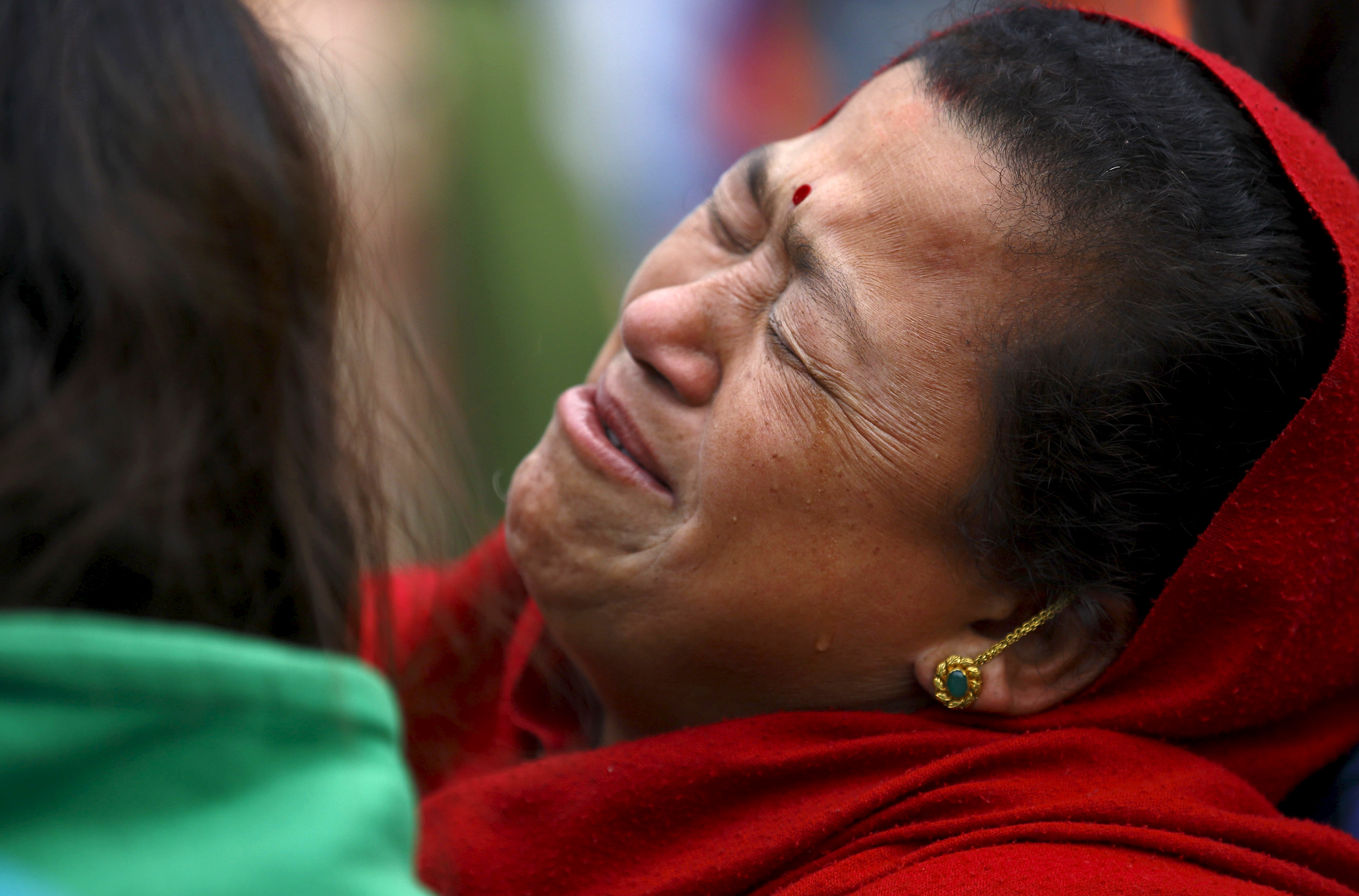 A woman mourns the death of a family member a day after an earthquake in Bhaktapur, Nepal April 26, 2015. Photo by Navesh Chitrakar/REUTERS.