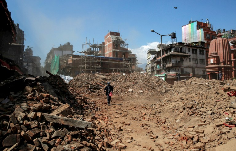 A Nepalese policeman walks through the rubble of collapsed buildings in the aftermath of Saturday's earthquake in Kathmandu, Nepal, on Monday. Photo by Danish Siddiqui/Reuters