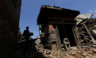 A boy walks past a damaged temple after Saturday's earthquake in Bhaktapur, Nepal on Monday. Photo by Adnan Abidi/Reuters